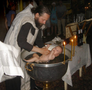 Infant baptism by immersion